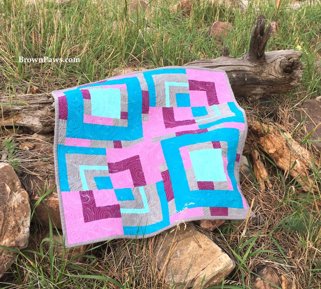 quilt on a log